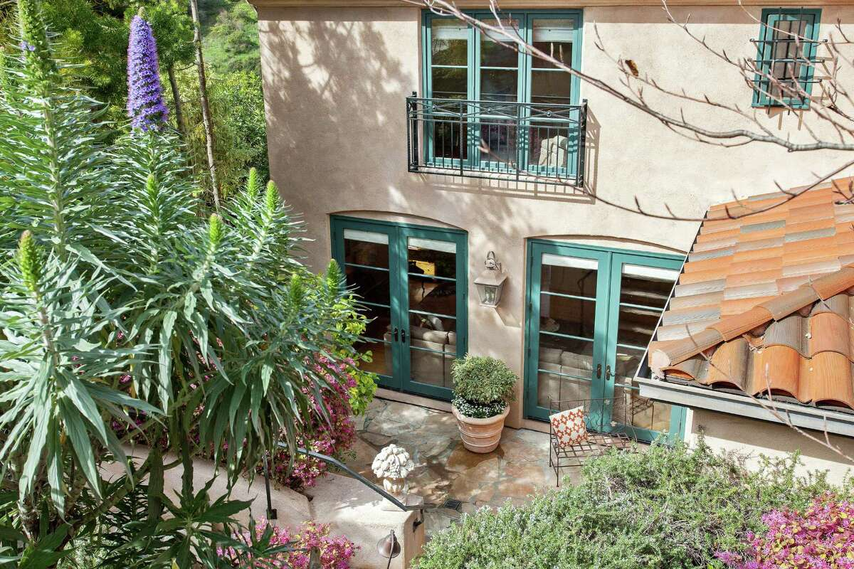 French doors off the main living level open to a flagstone patio.