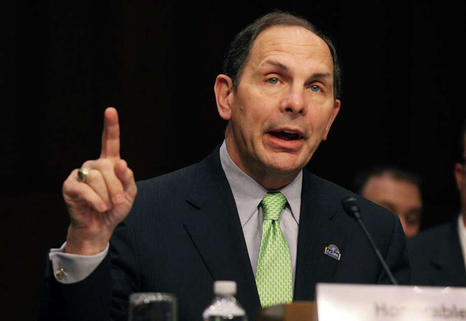 Veterans Affairs Secretary Robert McDonald says the agency  will now calculate the distance a veteran lives from a VA facility using Google maps and other websites rather than as the  crow flies. Photo: Lauren Victoria Burke / Associated Press / FR132934 AP