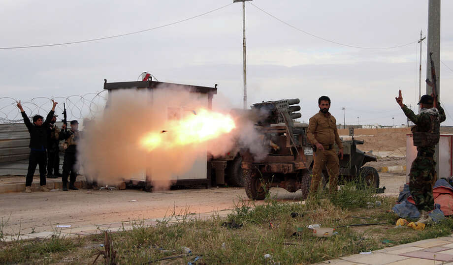An Iraqi Shiite militia group launches rockets against Islamic State positions in Tikrit. Photo: Khalid Mohammed / Associated Press / ASSOCIATED PRESS
