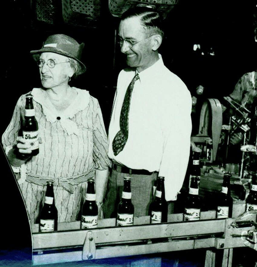 1. Emma Koehler took over Pearl Brewery in 1914 after her husband died, according to Hotel Emma's website. Koehler is seen here on the leftholding the first bottle of beer produced by Pearl Brewery after the repeal of Prohibition in 1933.