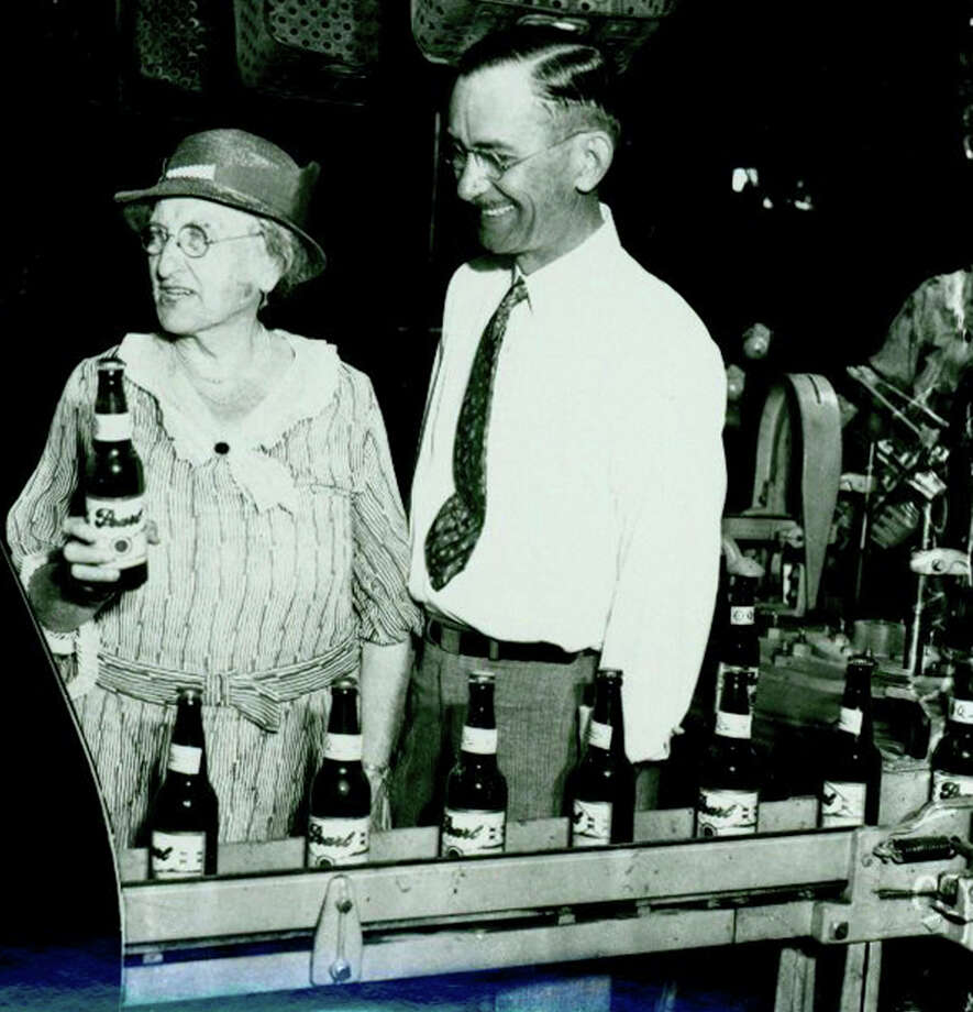 1. Emma Koehler took over Pearl Brewery in 1914 after her husband died, according to Hotel Emma's website. Koehler is seen here on the left holding the first bottle of beer produced by Pearl Brewery after the repeal of Prohibition in 1933.  Photo: Courtesy Photo /UTSA Libraries Special Collections / Institute of Texan Cultures