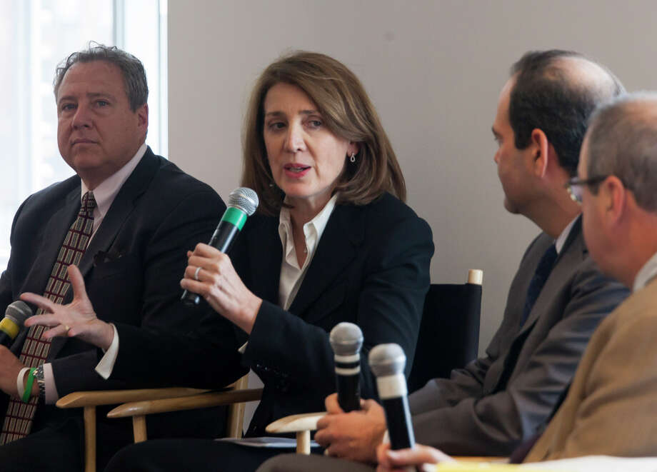 Ruth Porat (center), Morgan Stanley's chief financial officer, is leaving to join Google, becoming one of the most powerful women in Silicon Valley. Photo: MICHAEL NAGLE / New York Times / NYTNS