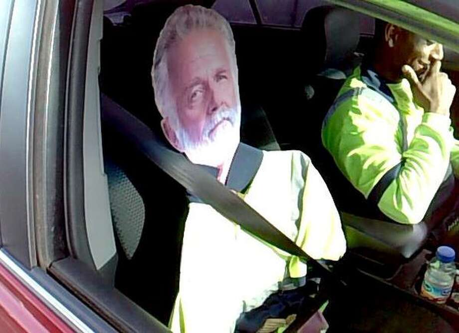 This man and his 'Most Interesting' friend were pulled over in Fife on March 23, 2015. Photo: Washington State Patrol