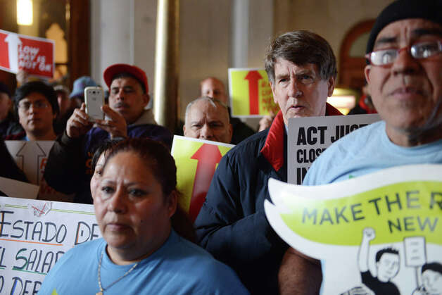 Minimum wage advocates hold a rally in support of increasing the state rate to $15 per hour Monday, March 23, 2015, at the Capitol in Albany, N.Y. (Will Waldron/Times Union) Photo: WW, Albany Times Union / 00031142A