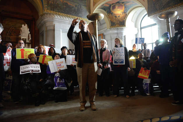 Terrence Melvin, president of the Coalition of Black Trade Unionists speaks to minimum wage advocates who rallied at the Capitol in support of increasing the state rate to $15 per hour Monday, March 23, 2015, in Albany, N.Y. (Will Waldron/Times Union) Photo: WW, Albany Times Union / 00031142A