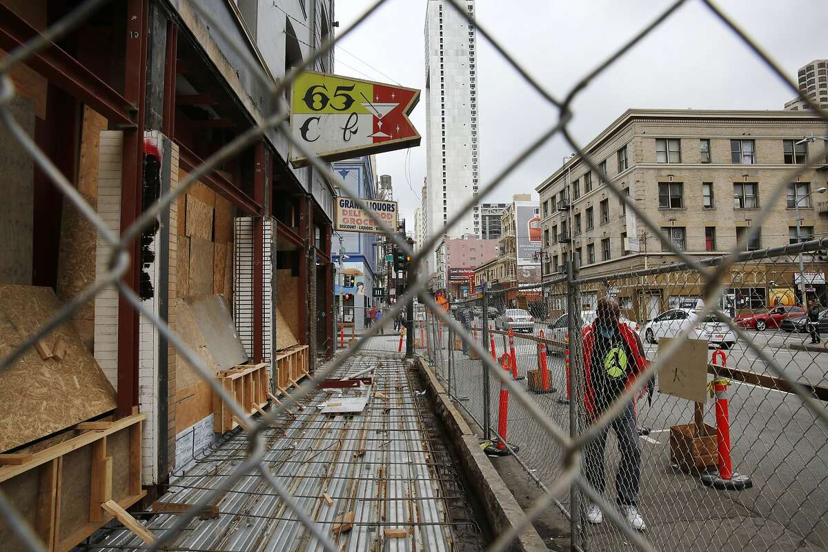 A pedestrian walks past a construction site of a future restaurant in the Tenderloin on Taylor and Turk Streets March 24, 2015 in San Francisco, Calif. Chefs Daniel Patterson and Roy Choi are starting a new restaurant on Turk and Taylor with the intent on serving inexpensive, sustainable and delicious food that is accessible to the local community.