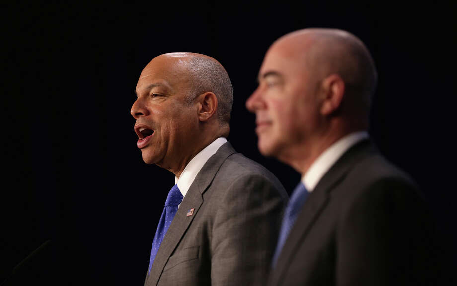 Alejandro Mayorkas, Homeland Security's No. 2 official (right), improperly helped foreign investors but retains the support of his boss, Jeh Johnson (left). Photo: Alex Wong / Getty Images / 2015 Getty Images
