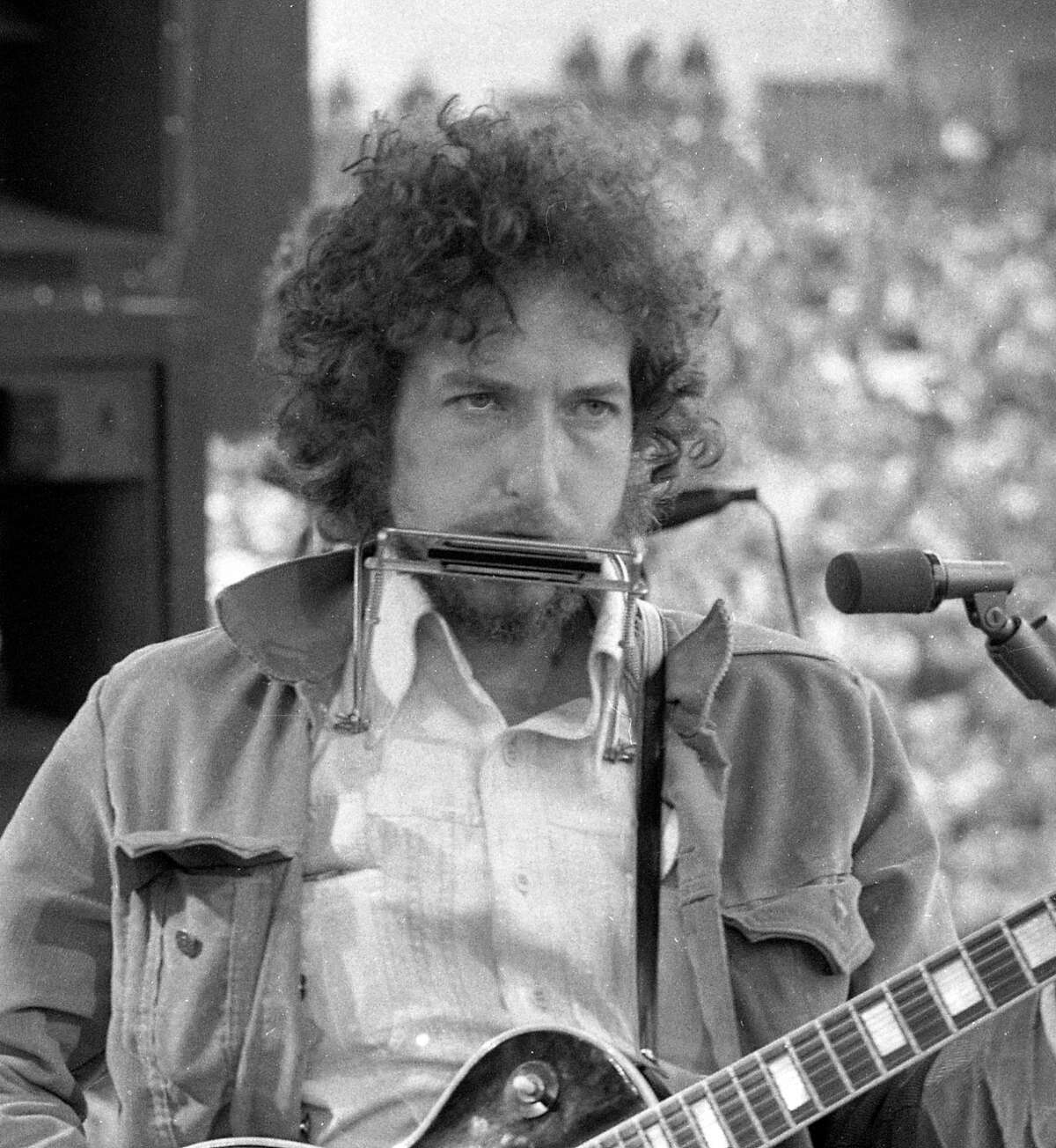 March 23, 1975: Bob Dylan makes a surprise appearance at the SNACK concert, a Kezar Stadium benefit organized by Bill Graham to save San Francisco high school sports. The benefit included performances by Jerry Garcia and Carlos Santana and appearances by Marlon Brando and Willie Mays.