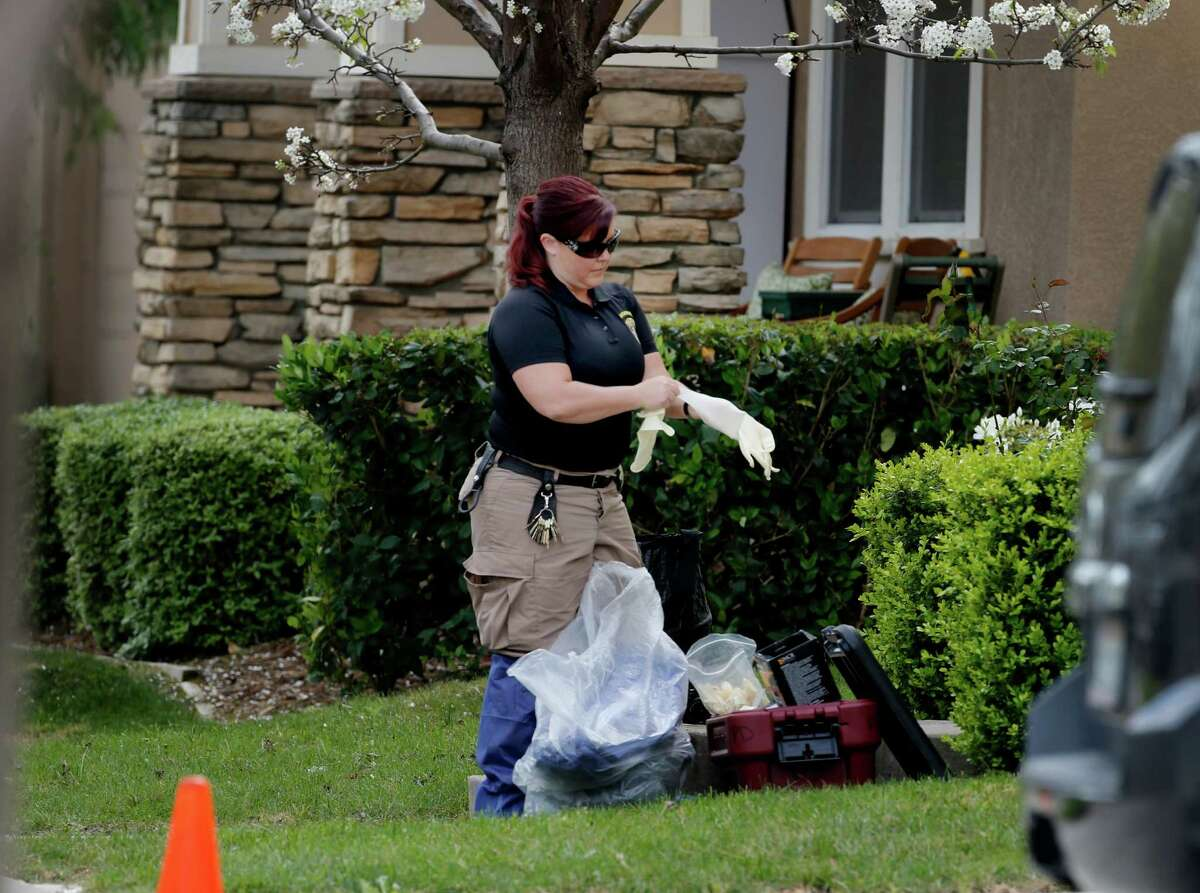 A CSI officer put on gloves before entering the home of Denise Huskins, a Kaiser Permanente physical therapist who is the apparent victim of a kidnapping for ransom.