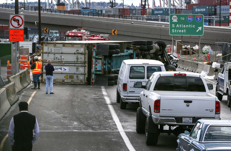 A semi truck overturned on Highway 99 in downtown Seattle Tuesday afternoon, shutting southbound lanes of the highway. Photo: JOSHUA TRUJILLO, SEATTLEPI.COM / SEATTLEPI.COM