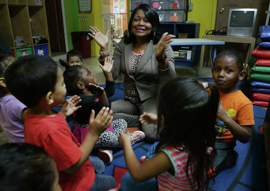 Alma Johnson, owner of Training Wheels Learning Center, leads children in a game at one of her two child care centers. Johnson participated in LiftFund's Women's Mentorship Program last year. Photo: Bob Owen /San Antonio Express-News / © 2015 San Antonio Express-News