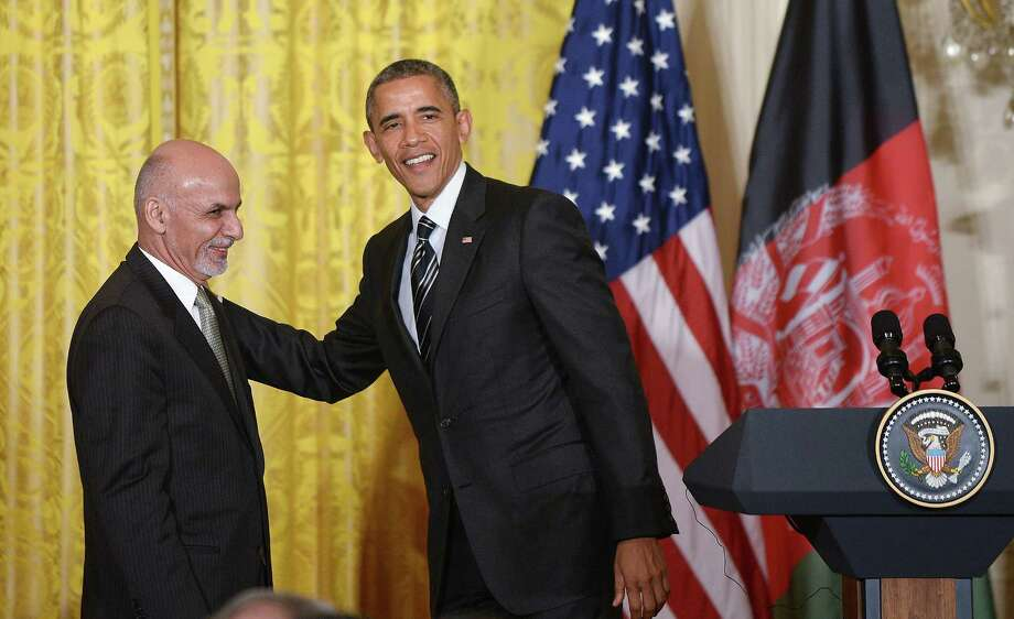 "With Afghan President Ashraf Ghani at his side, President Barack Obama said the U.S. troop extension is needed ""so we don't have to go back."" Photo: Olivier Douliery /McClatchy-Tribune News Service / TNS"