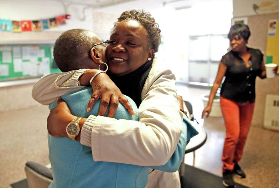Lottie Titus, a longtime resident of the Bayview who helps kids deal with trauma from violence, hugs Principal Imani Cooley at Malcolm X Academy in San Francisco, Calif., on Tuesday, March 24, 2015. Photo: Scott Strazzante / The Chronicle / ONLINE_YES