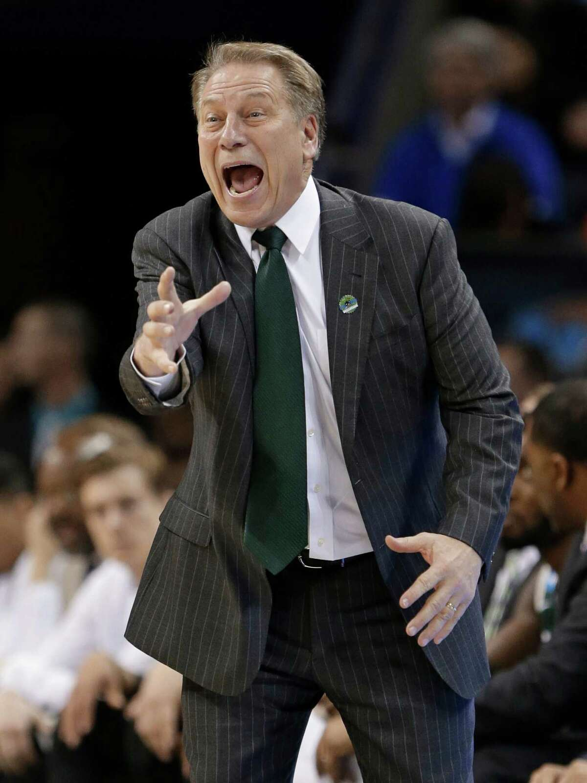 Michigan State head coach Tom Izzo directs his team against Virginia during the second half of an NCAA tournament college basketball game in the Round of 32 in Charlotte, N.C., Sunday, March 22, 2015. (AP Photo/Gerald Herbert)