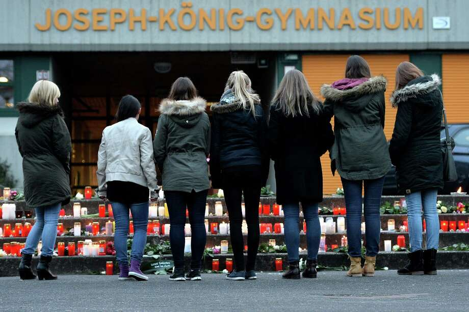 HALTERN AM SEE, GERMANY - MARCH 24:  Students and well wishers gather in front of the Joseph-Koenig-Gymnasium secondary school in Haltern am See, Germany on March 24, 2015, from where some of the Germanwings plane crash victims came. Sixteen German teenagers and two teachers on a school exchange trip were assumed to be among the 150 dead in the crash of a passenger jet in the French Alps, officials said. The head of low-budget airline Germanwings said there were 144 passengers and six crew on the Airbus A320 that crashed in the French Alps en route to Duesseldorf from Barcelona.  (Photo by Sascha Steinbach/Getty Images) Photo: Sascha Steinbach, Stringer / Getty Images / 2015 Getty Images