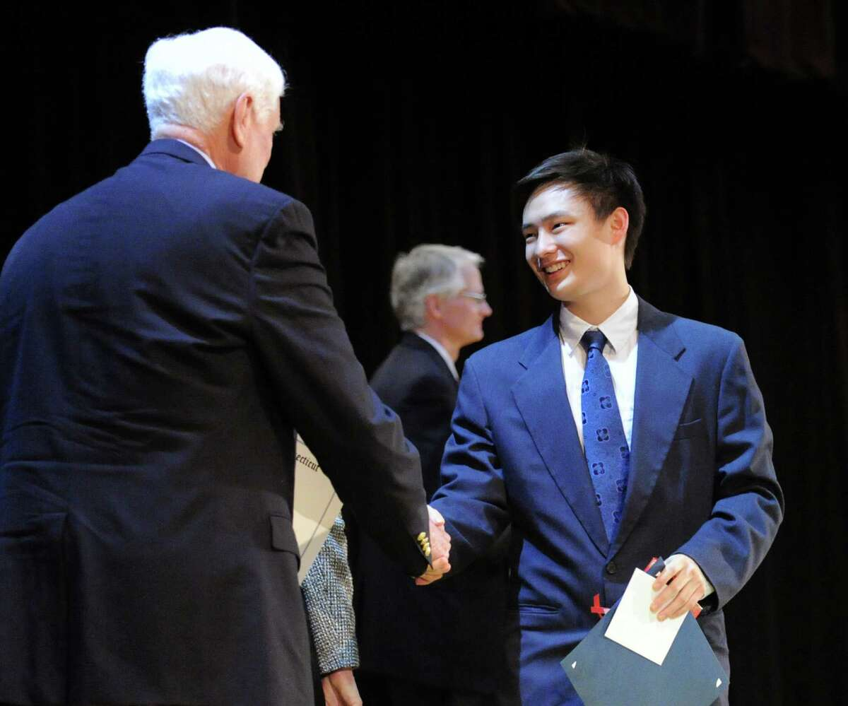Greenwich Selectman John Toner shakes hands with Greenwich High School student and Fleishman Service Award winner Stephen Song, right, during the Greenwich Public Schools Community Service Awards ceremony at Western Middle School in Greenwich, Conn., Tuesday, March 24, 2015. The Fleishman Service Award is named after former Superintendent of Schools, Dr. Ernest Fleishman and is given to the student who has made outstanding community service contributions to both school and community.