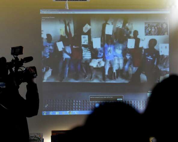 Susan Fowler's  second grade student participates in their Skype session with 18 boys in the Kampala Orphanage in Uganda Tuesday morning March 24, 2015 at the Delaware Community School in Albany, N.Y.   (Skip Dickstein/Times Union) Photo: SKIP DICKSTEIN / 00031133A