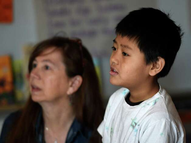 Naing Aung, right asks questions during Susan Fowler's second grade participation in the Skype session with 18 boys in the Kampala Orphanage in Uganda Tuesday morning March 24, 2015 at the Delaware Community School in Albany, N.Y.   (Skip Dickstein/Times Union) Photo: SKIP DICKSTEIN / 00031133A