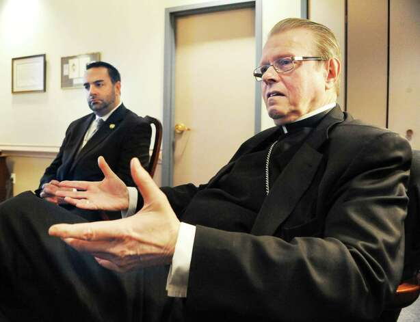 Superintendent of Schools for the Diocese of Albany, Michael Pizzingrillo,left, and Bishop Edward Scharfenberger discuss plans for Bishop Maginn High School during an interview at the Pastoral Center Tuesday March 24, 2015 inAlbany, NY.  (John Carl D'Annibale / Times Union) Photo: John Carl D'Annibale / 00031151A