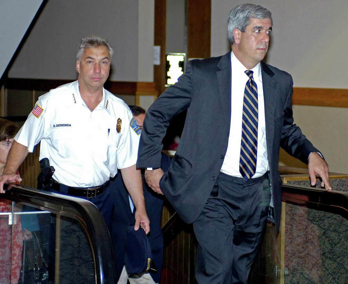 File - Erie County District Attorney Frank Sedita, right, Sunday, Aug. 15, 2010, in Buffalo, N.Y. (AP Photo/Don Heupel)