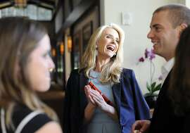 """Director Jennifer Siebel Newsom mingles with guests before the screening of her new film, """"The Mask You Live In"""" at the Premiere Theater in the Letterman Digital Arts Center in San Francisco, CA, on Monday, March 23, 2015."""