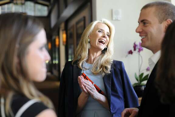 "Director Jennifer Siebel Newsom mingles with guests before the screening of her new film, ""The Mask You Live In"" at the Premiere Theater in the Letterman Digital Arts Center in San Francisco, CA, on Monday, March 23, 2015."