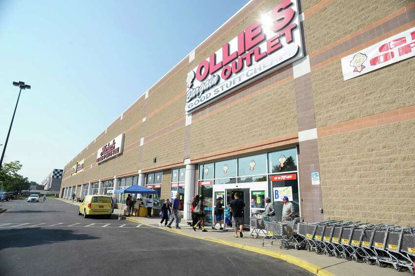 Customers make their way in for the grand opening of Ollie's Bargain Outlet at Crossgates Commons on Wednesday, Aug. 21, 2013 in Albany, NY. This is the 145th store for the chain, which bills its self as an extreme discounter of name brand items.
