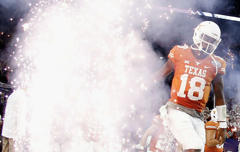 Tyrone Swoopesof the Texas Longhorns runs with his team onto the field at the start of their game against the Arkansas Razorbacks at the Texas Bowl at NRG Stadium on Dec. 29, 2014 in Houston. Photo: Scott Halleran /Getty Images / 2014 Getty Images