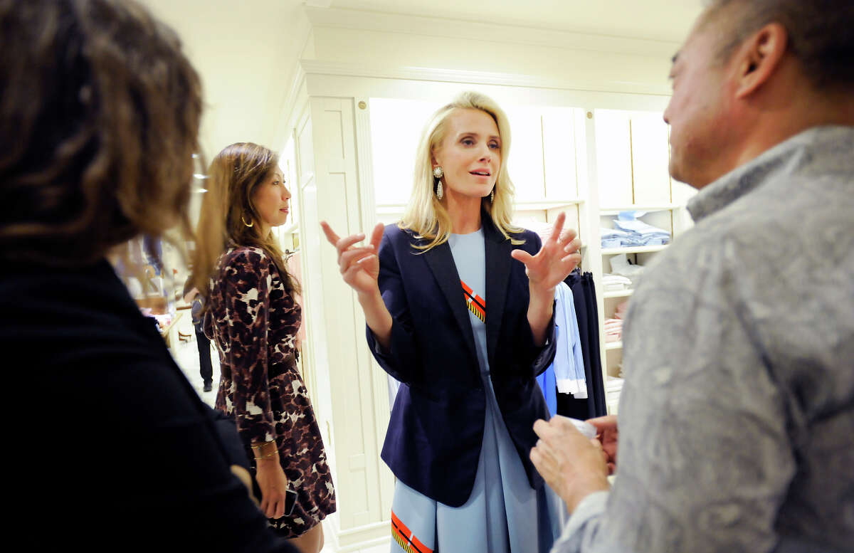 Director Jennifer Siebel Newsom (center) talks with guests during a reception for her new film,