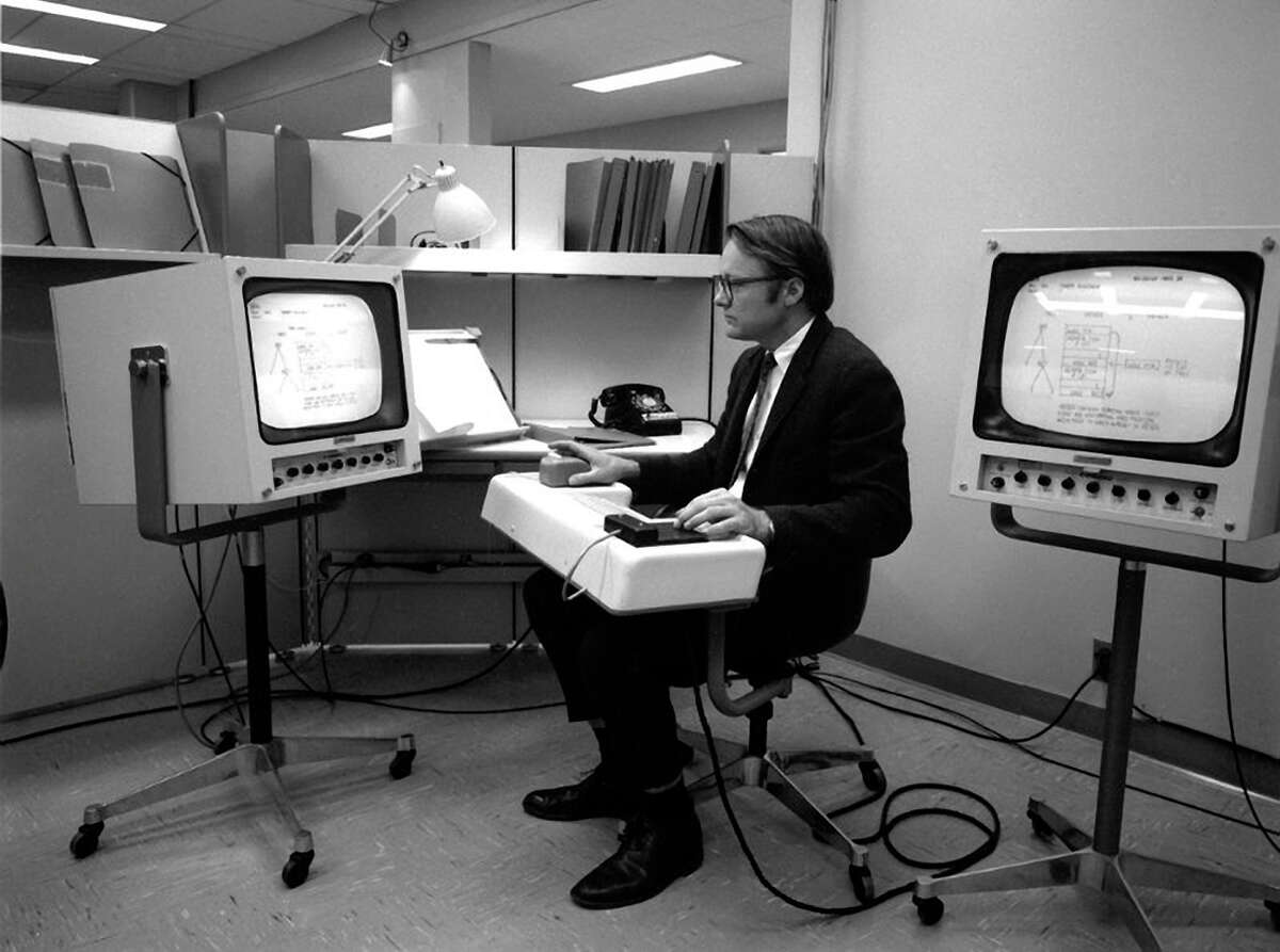 In a late-1960s photo, engineer William English tests the first mouse.