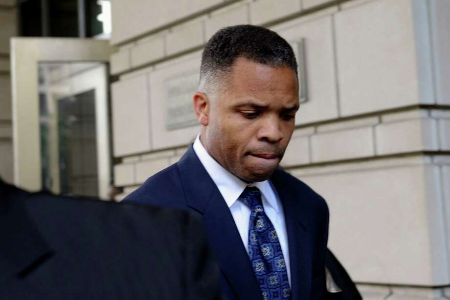 Jesse Jackson Jr. has been at the minimum security federal prison camp in Montgomery, Ala., , leaves federal court in Washington after being sentenced to 2 1/2 years in prison for misusing $750,000 in campaign funds. Jackson Jr. will be released from a federal prison on Thursday, March 26, 2015, and will serve out the remainder of his term in a Washington, D.C., halfway house, former U.S. Rep. Patrick Kennedy told The Associated Press after visiting Jackson behind bars. (AP Photo/Susan Walsh, File) Photo: Susan Walsh /Associated Press / AP