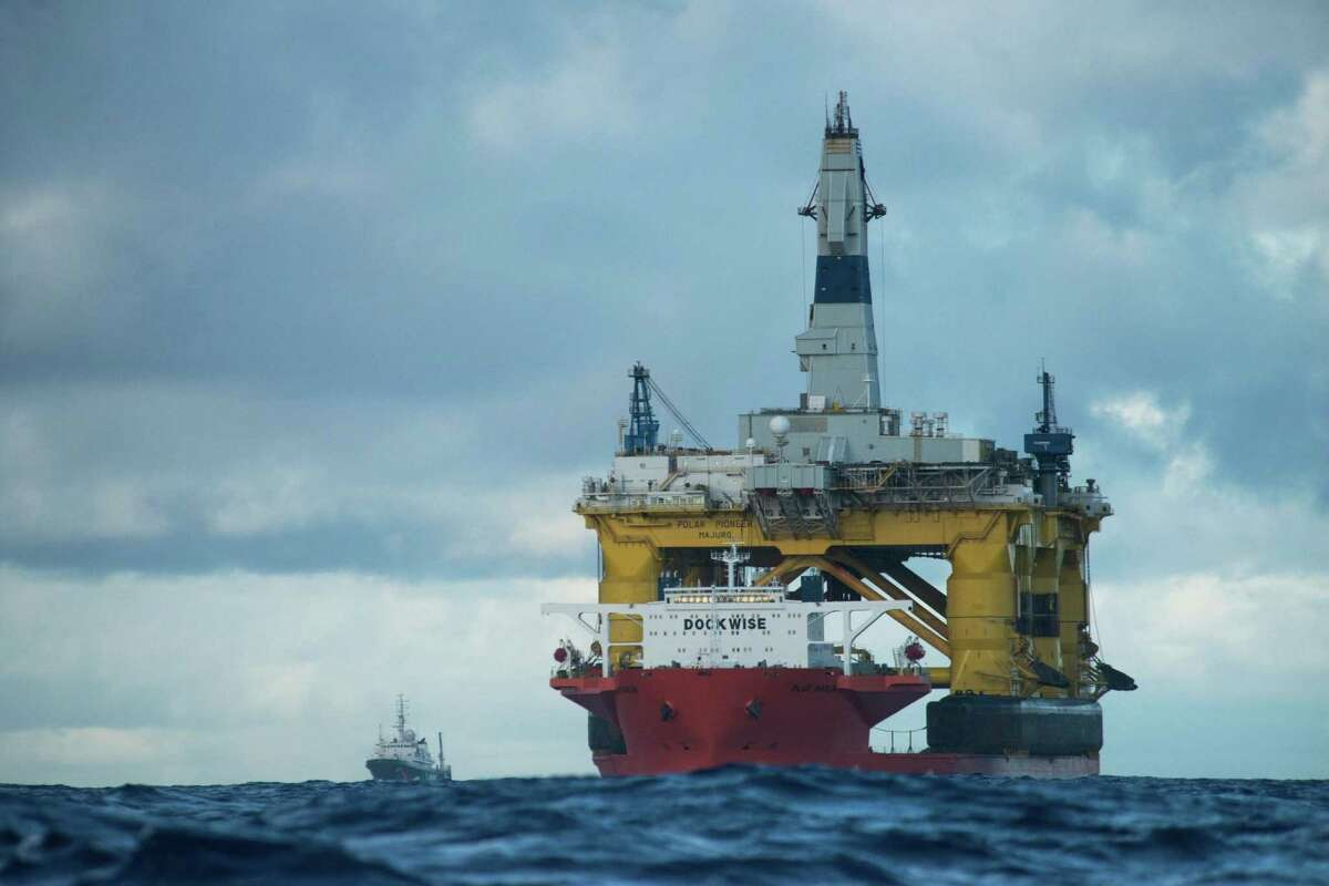The heavy-lift vessel Blue Marlin transports Transocean's Polar Pioneer drilling rig, which Shell Oil Co. has contracted for 2015 exploration in the Chukchi Sea off Alaska. Greenpeace activists aboard the ice-class Esperanza tracked the Polar Pioneer during its trek in early 2015 across the Pacific to the Port of Seattle, where Shell planned to prepare it and other equipment for Arctic work. (Photo: Vincenzo Floramo / Greenpeace)