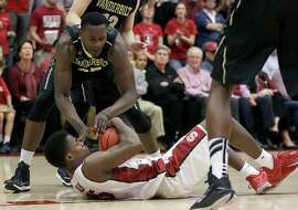 Stanford's Marcus Allen, bottom, tries to control the ball under Vanderbilt's James Siakam during the second half of an NCAA college basketball game in the National Invitation Tournament in Stanford, Calif., Tuesday, March 24, 2015. Stanford won 78-75. (AP Photo/Jeff Chiu)