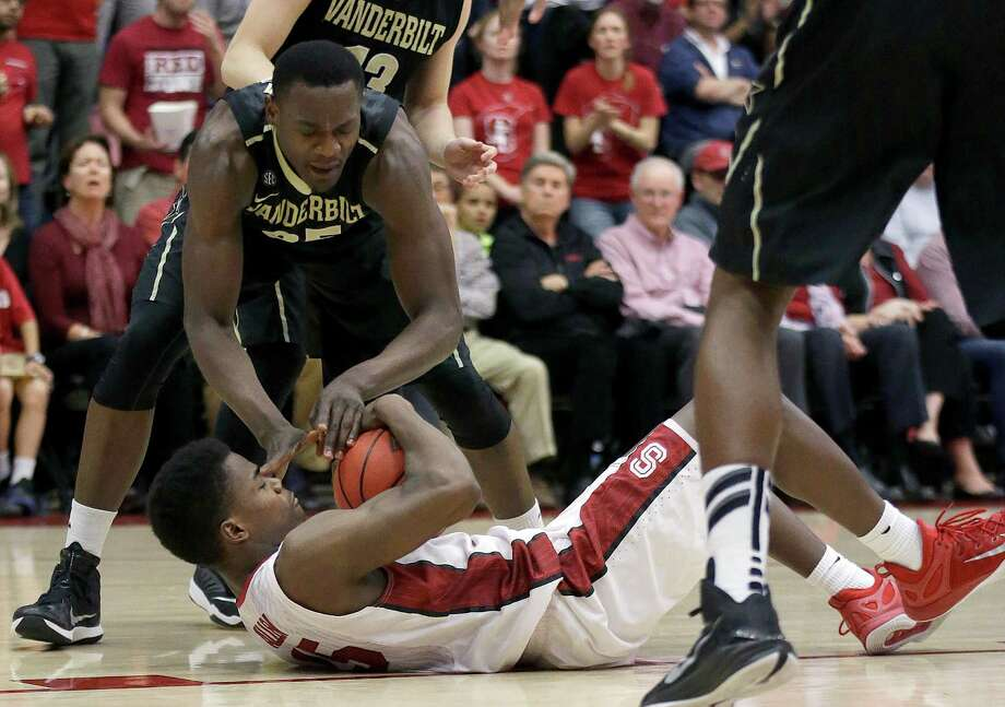 Stanford's Marcus Allen, bottom, tries to control the ball under Vanderbilt's James Siakam during the second half of an NCAA college basketball game in the National Invitation Tournament in Stanford, Calif., Tuesday, March 24, 2015. Stanford won 78-75. (AP Photo/Jeff Chiu) Photo: Jeff Chiu / Associated Press / AP