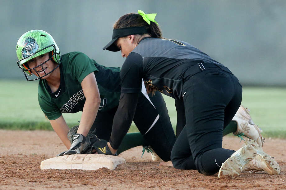 Southwest's Kristal Salinas (left) looks up after stealing second base on East Central's Haydi Bugarin during the third inning of their District 28-6A softball game at East Central on Tuesday, March 24, 2015. East Central beat Southwest 4-2.  MARVIN PFEIFFER/ mpfeiffer@express-news.net Photo: Marvin Pfeiffer, Staff / San Antonio Express-News / Express-News 2015