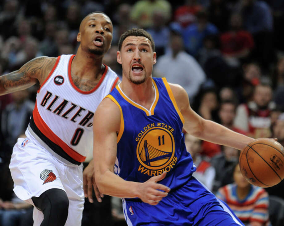 Klay Thompson drives past Damian Lillard of Portland — and Oakland. Photo: Greg Wahl-Stephens / Associated Press / FR29287 AP