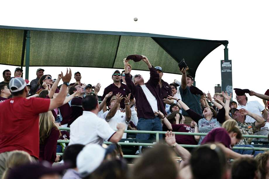 An A&M fan attempts to catch a foul ball with his hat during the non-conference game between the University of Texas San Antonio Roadrunners and the Texas A&M Aggies at Nelson W. Wolff Municipal Stadium in San Antonio, Tx. on Tuesday, March 24, 2015. Photo: Matthew Busch, For The San Antonio Express-News / For The San Antonio Express-News / © Matthew Busch
