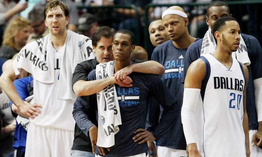 Mavericks owner Mark Cuban and guard Rajon Rondo look on as an NBA basketball game comes to an end against the Spurs, Tuesday in Dallas. Dallas won 101-94. Photo: Brandon Wade /Associated Press / FR168019 AP