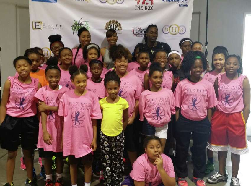 Girlz Rule Mentor Coaches Jimmele Melvin, Tina Thompson, and Jahaziel Howard pose with the group.