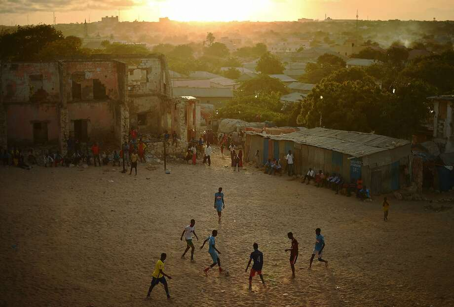 Somalis play football as the sun sets in Mogadishu on March 24, 2015.  Photo: Carl De Souza, AFP / Getty Images