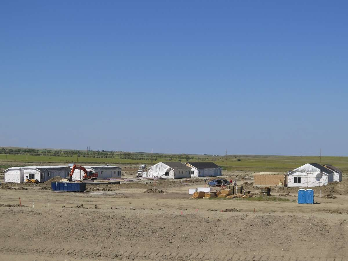 This July 30, 2014 photo shows construction of the Epping Ranch development in Epping, N.D. At the moment, Epping has fewer than 100 residents and has largely escaped the population explosion brought on by the state's oil boom. This development is set to change that, bringing in 400 homes to the area. (AP Photo/Josh Wood)