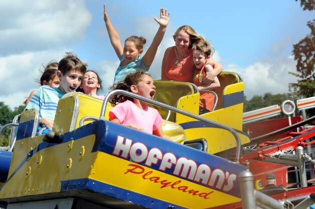 Children and their families scream as round a curve on the roller coaster on Friday, Aug. 29, 2014, at Hoffman's Playland in Latham N.Y. (Cindy Schultz / Times Union) Photo: Cindy Schultz, Albany Times Union