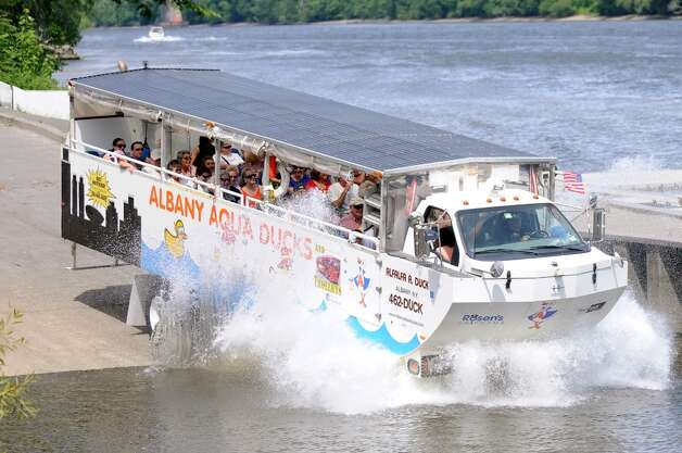 An Albany Aqua Ducks vehicle enters the Hudson River on Thursday, July 5, 2012, in Albany, N.Y. The Albany Aqua Ducks has sold its two amphibious vehicles to an unidentified buyer, who will move them out of state. The company will continue tours until July 15. (Cindy Schultz / Times Union) Photo: Cindy Schultz, Albany Times Union