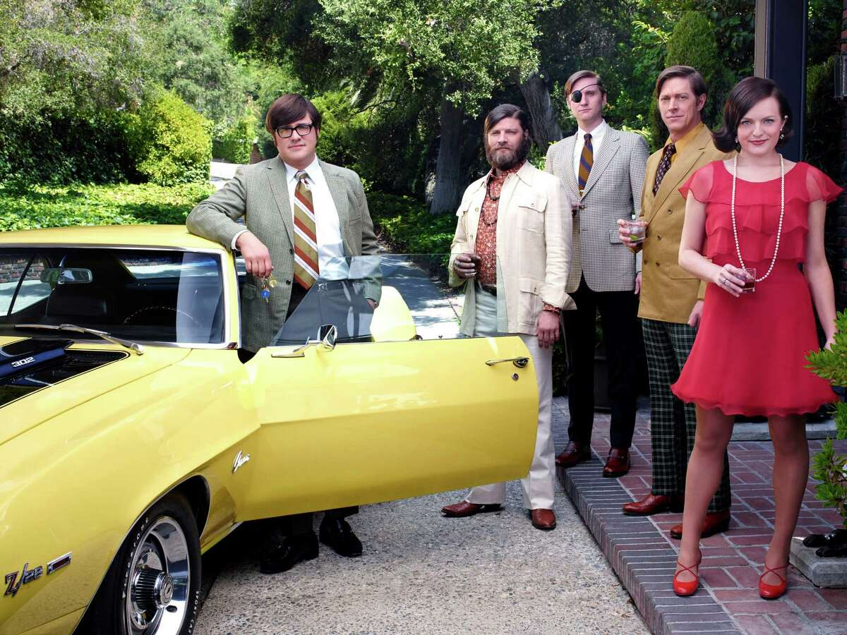 Rich Sommer as Harry Crane, Jay R. Ferguson as Stan Rizzo, Aaron Stanton as Ken Cosgrove, Kevin Rahm as Ted Chaough and Elisabeth Moss as Peggy Olson in Mad Men's season 7B.
