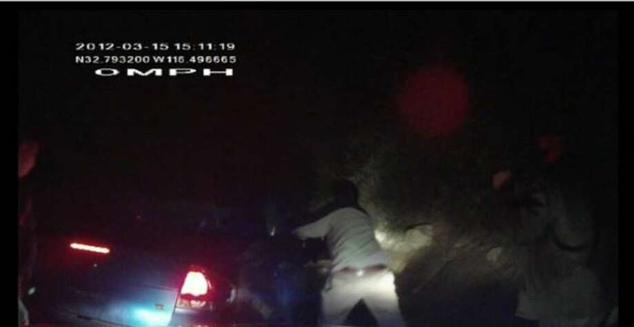 Border Patrol agents were involved in a high-speed pursuit that eventually led to an agent firing a Taser at the driver of the involved vehicle. An explosion occurred when the Taser was fired and the driver was burned to death. The dashcam video footage shows agents backing their vehicles away from the vehicle engulfed in flames. Photo: White, Tyler L, Screengrab