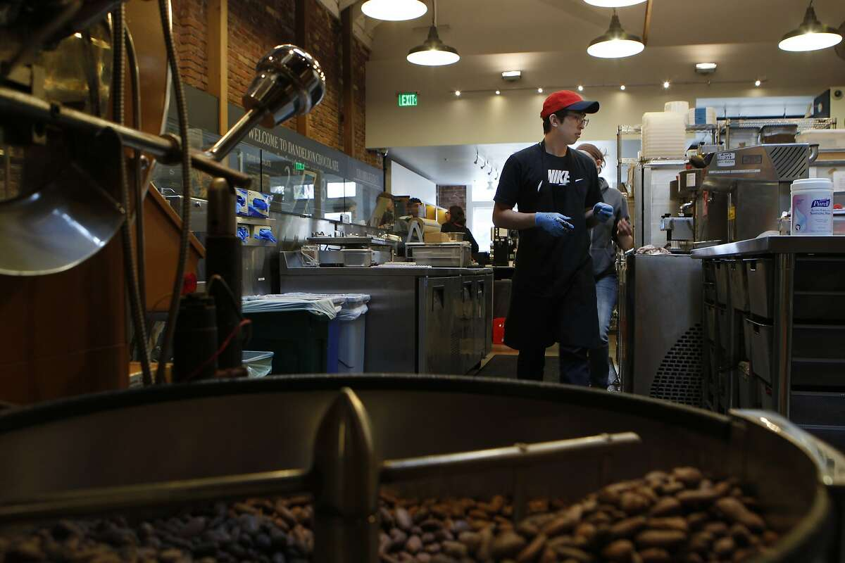 Trevor Fast, chocolate manager, makes his way through the Dandelion Chocolate facility, Tuesday, March 24, 2015, in San Francisco, Calif.