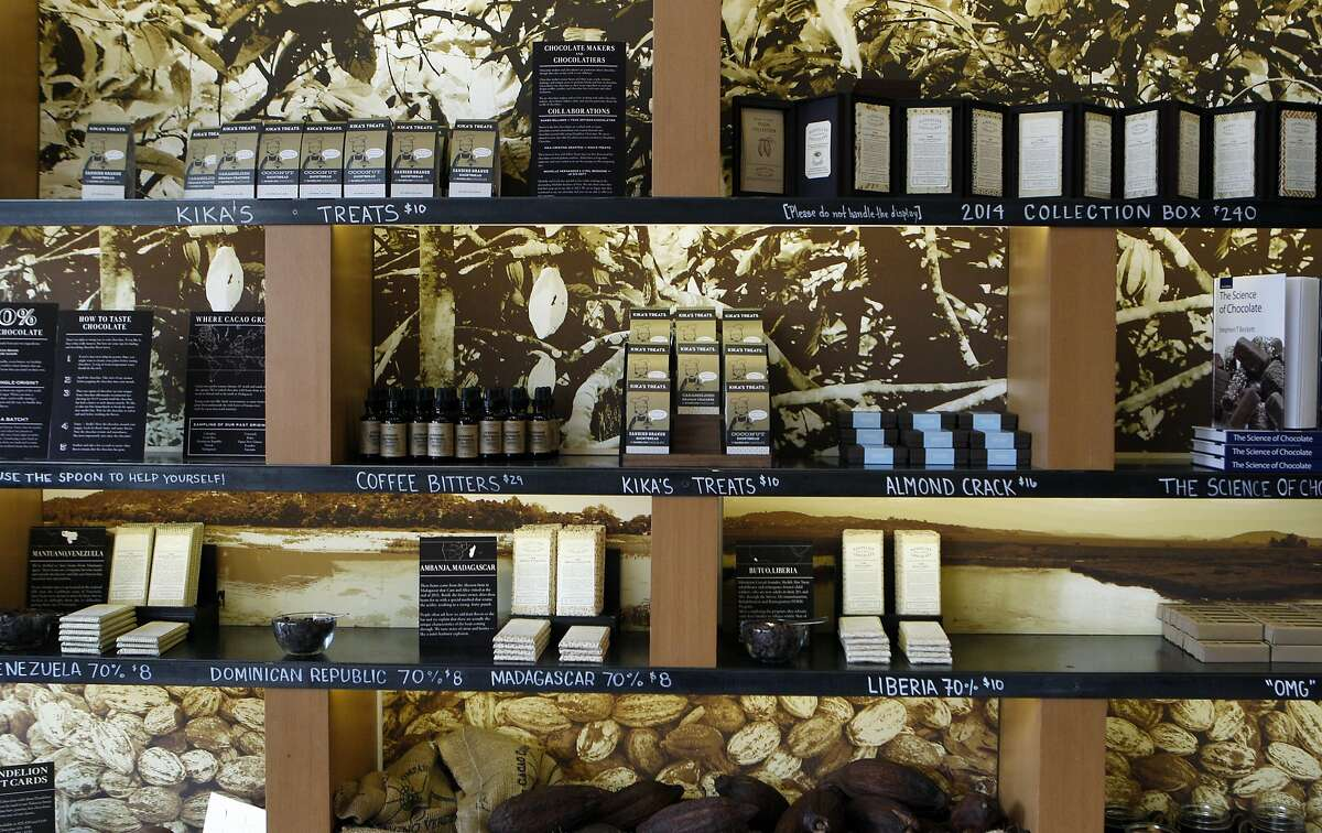 A variety of chocolate is set up at the shelves for customer's to sample and make a purchase at Dandelion Chocolate, Tuesday, March 24, 2015, in San Francisco, Calif.