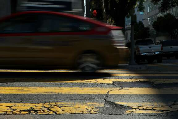 Cracks and potholes on the road are seen at Golden Gate Avenue along Franklin Street, Wednesday, March 18, 2015, in San Francisco, Calif. The roads are heavy with damage along Franklin and Gough streets giving motorists a bumpy ride.