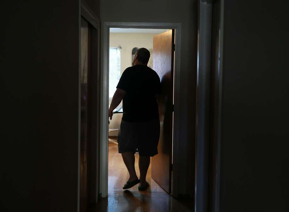 Edwin Neil Acosta walks into the bedroom of his apartment in San Francisco, Calif. on Wednesday, March 25, 2015. Acosta's life is returning to normal after enduring two years of constant noise coming from as many as 10 temporary residents at a time that would be staying in the apartment above his in an Airbnb-style arrangement with the tenant, who eventually moved out following numerous complaints from Acosta. Photo: Paul Chinn, The Chronicle
