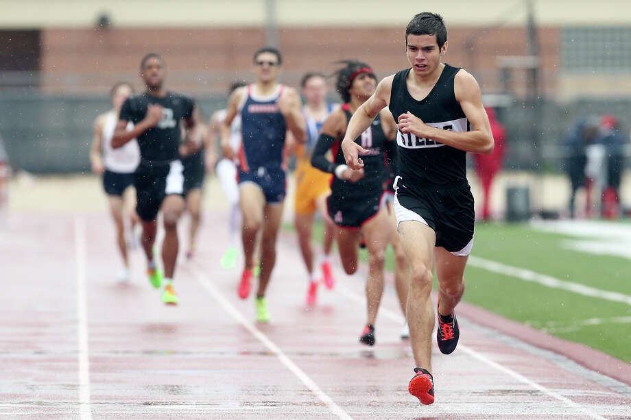 Steele's Garett Cortez crosses the finish line of the 800-meter run during Judson's Ron Faught Invitational at Rutledge Stadium on March 21, 2015. Cortez won the event with a time of one minute, 57.25 seconds. Photo: Marvin Pfeiffer /San Antonio Express-News / Express-News 2015